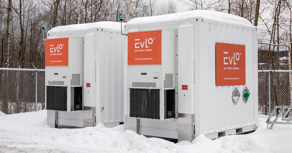 Two EVLO energy storage containers outside in the winter.
