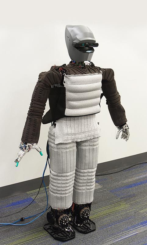 Hubo robot dressed in touch-sensitive, functional fabric suit.