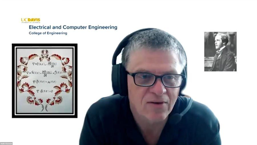 A still shot from a Zoom distance-learning class showing Professor Knoesen speaking to the camera and wearing headphones.