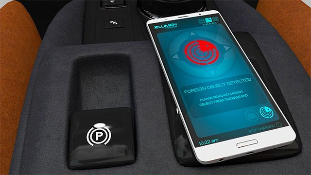 Mobile phone inside a vehicle displaying a foreign object alert.